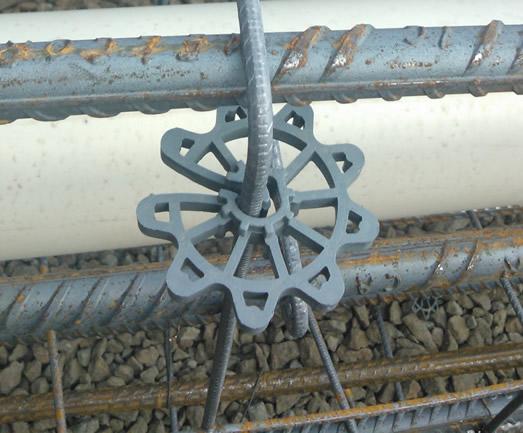 foto do espacador para concreto aplicado na ferragem